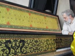 "Jenison examines the harpsichord he built as part of the recreation of the room for his experiment with ""The Music Lesson"""
