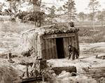 """This photo, shot by Timothy H. O'Sullivan (1840-1882), shows Sutler's bomb-proof """"Fruit and Oyster House"""" located in Petersburg, Virginia, during the siege of Petersburg (June 1864-April 1865)."""